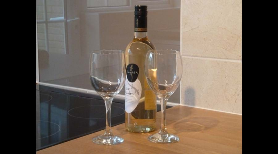 A bottle of chilled white wine awaits your arrival.