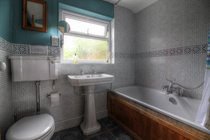 Family bathroom with double ended bath and over bath shower