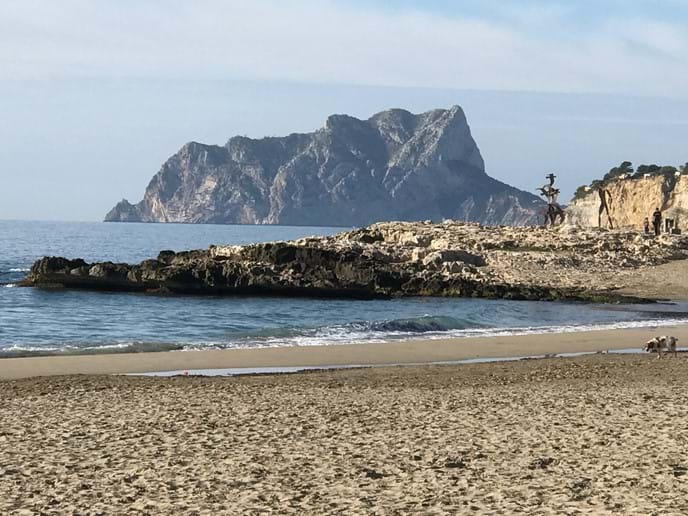 Morning stroll on Moraira beach, views to the Penon d