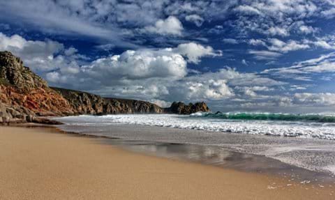Porthcurno beach towards Logan Rock Cornwall