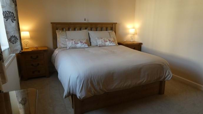 Rear king size bedroom with views over next doors garden