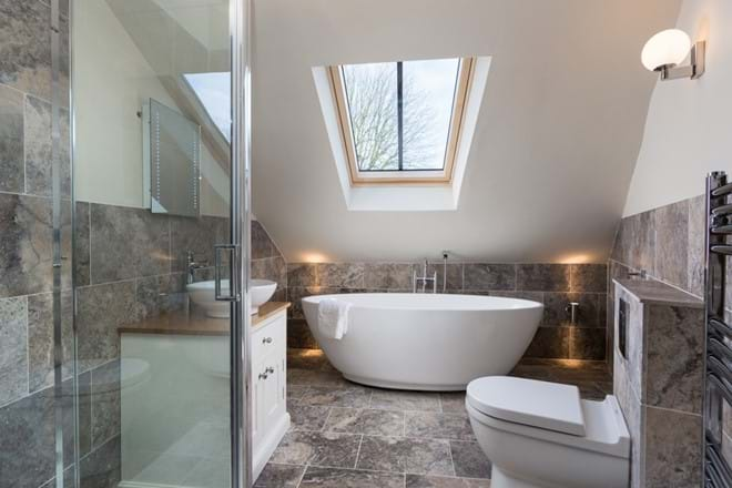 The main house bathroom with shower and bath