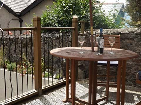 Enjoy relaxing or a meal on the raised mezzenine deck; one of two outside seating areas