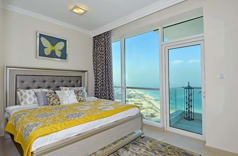"""""""Bedroom 2 with full sea views! Enjoy a restful night's sleep in the king-sized Sweet Dreams bed"""""""