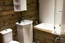 Re-purposed wood-clad bathroom, Chapel Bay Lodge
