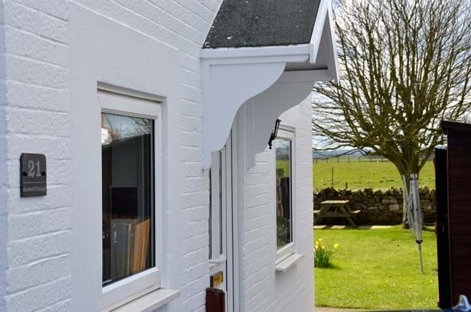 Front door looking to rear garden