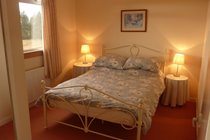 Double room with wardrobes situated upstairs.