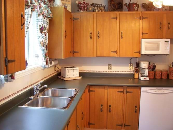 The clean and tidy kitchen is well equipped with good appliances and stainless steel pots and pans.
