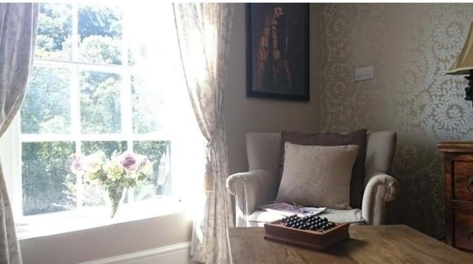 RELAX IN THE  ARMCHAIR & ENJOY THE VIEW OF THE IRON BRIDGE at IRONBRIDGE VIEW TOWNHOUSE