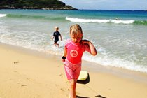 Body boarding fun with kids in August on Kiloran