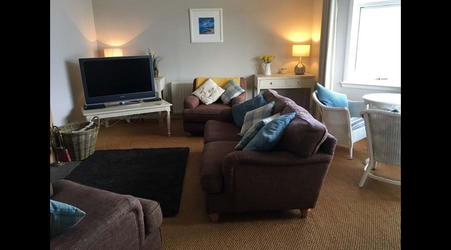 Spacious lounge showing bay window seating.