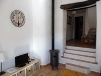 Log Burner and Steps up to another Seating Area.