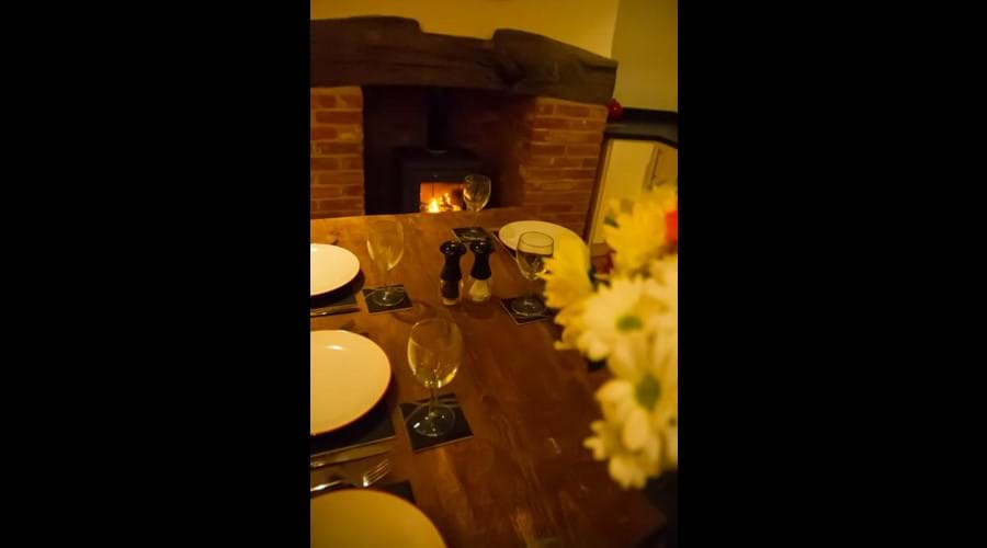 Benbow Cottage - dining infront of a roaring wood burner