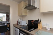 Fully equipped modern kitchen with washing machine