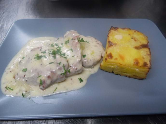 Pork Loin with Leek and Mustard Sauce with Dauphinoise Potatoes.