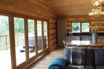 Large Bi-folding doors opening out onto the deck with the hot tub