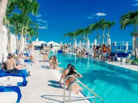 Adults only rooftop pool with bar and food