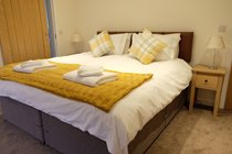 The larger bedroom can be configured as a kingsize double.