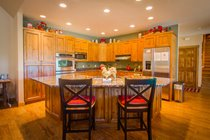 A fully equipped gourmet kitchen with La Crusett cookware