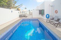 Gated pool area ideal for tots- sofa and shade overlooks the pool