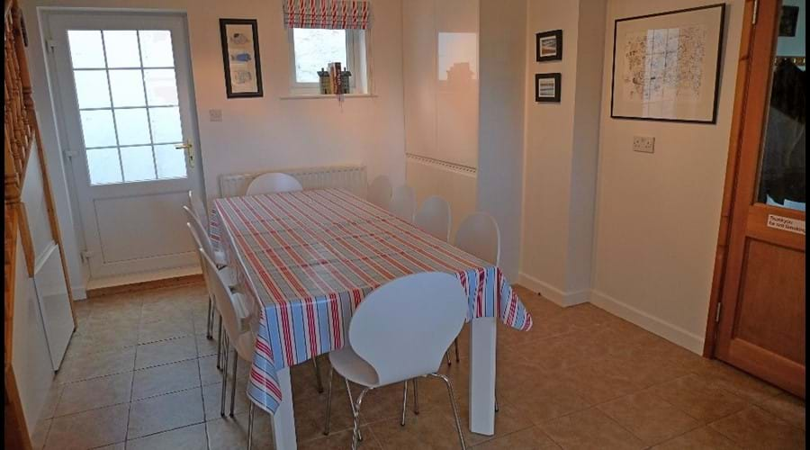 Large table seating 10 people in comfort and style - perfect for a celebration dinner!