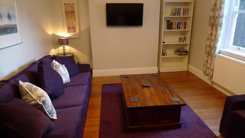 Second sitting room with X Box, flatscreen TV, books and games