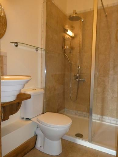 En-suite shower room to single room with luxury massage jet, rainfall shower