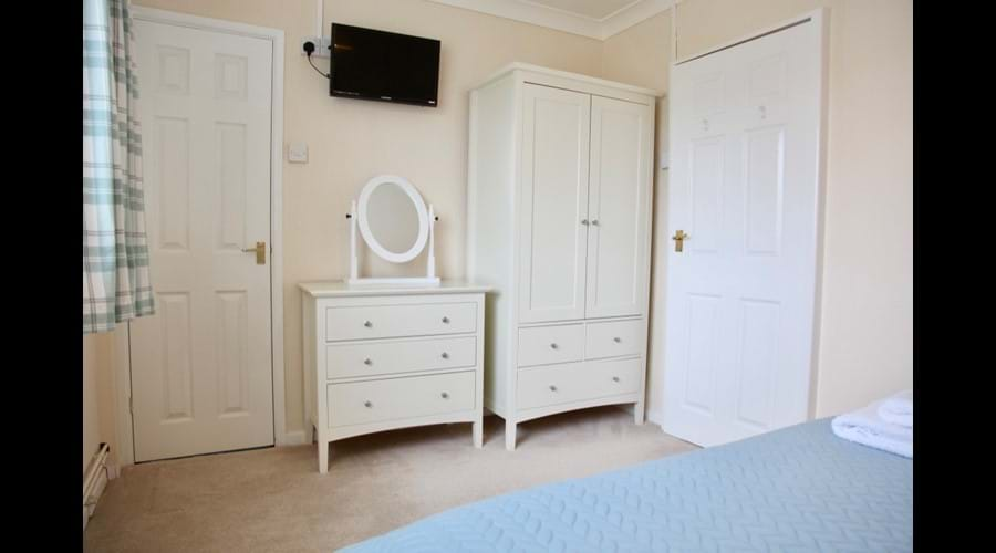 Ample storage and TV in every bedroom