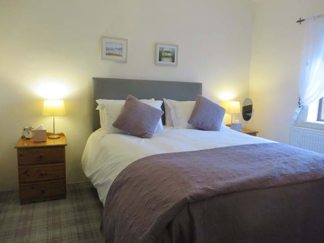 Double bedroom has king size bed, double wardrobe and en-suite with shower, wc and basin