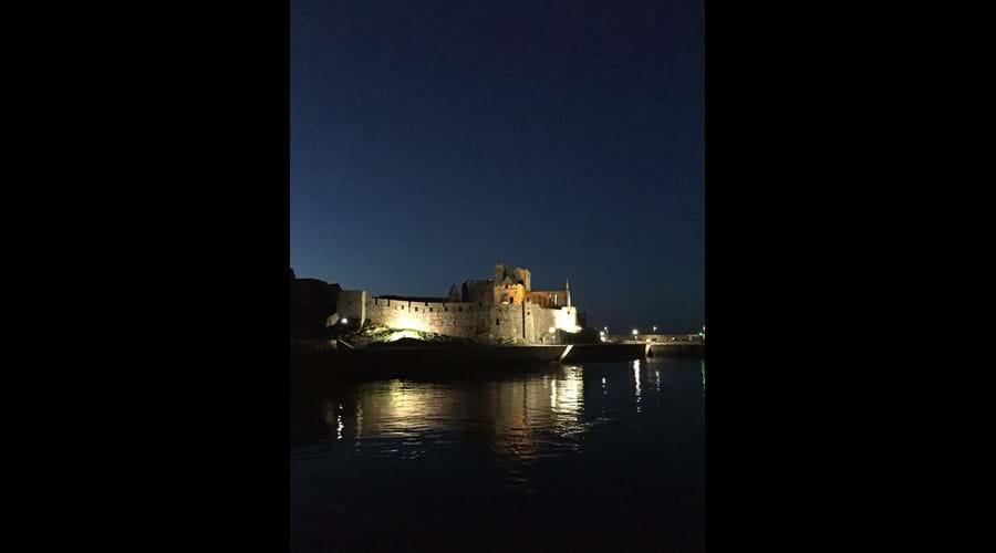 Peel Castle illuminated at dusk