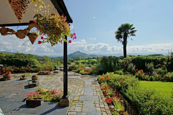 photo showing terrace with views over to Cardigan Bay and the southern Snowdonia Rhinog mountain range