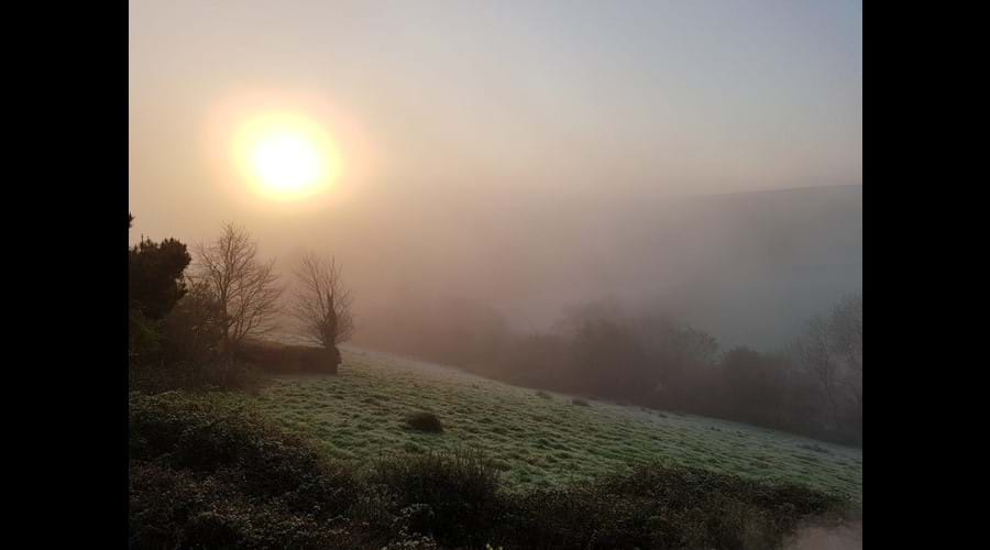 A misty winter's sunrise at Great Hills Lodge