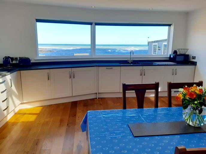 The kitchen is huge, light and airy, with a spectacular sea view