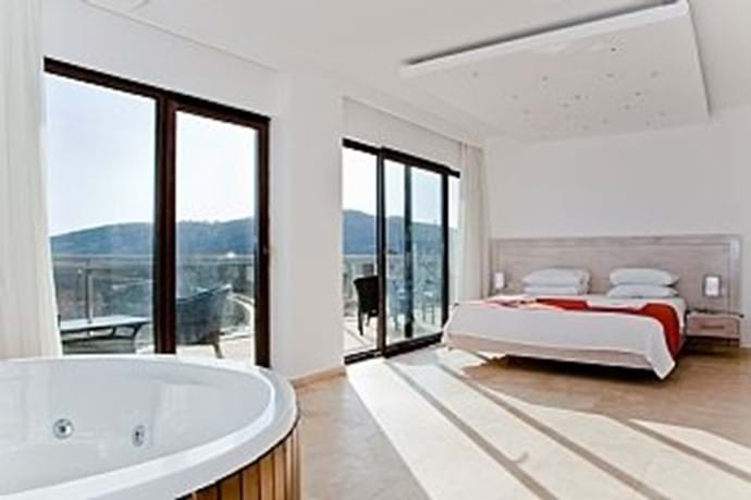 The master bedroom has its own jacuzzi