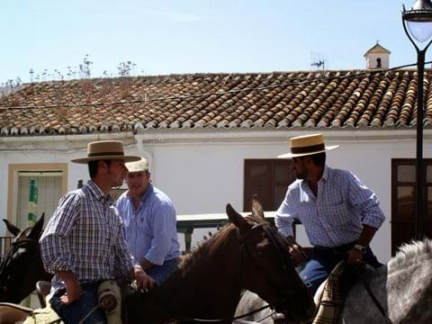 A Sunday horse-riding group stop in the village for a drink