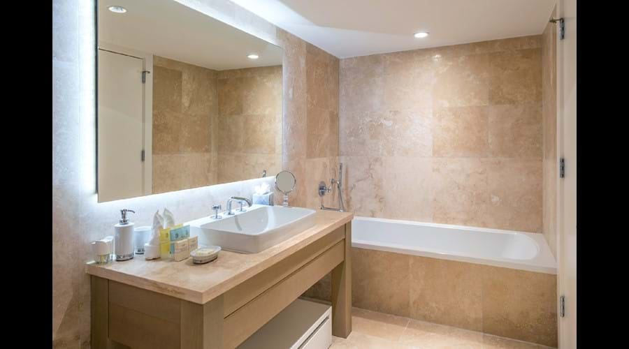 """""""Bathrooms finished in beautiful, floor-to-ceiling Travertine , Large bath """""""