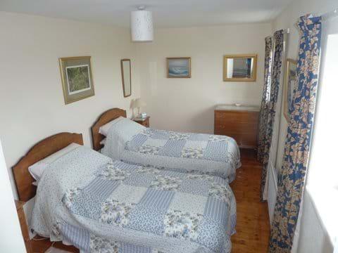 Twin bedroom in Smeale Farm Cottage.