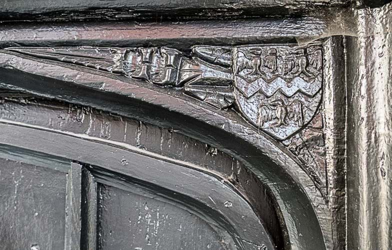 Carved Spandrel on outside of house, three eagles