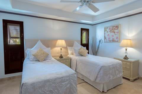 Bedroom 2 at Coral Cove 12, set up with full sized twin beds. Can be set with king size beds.