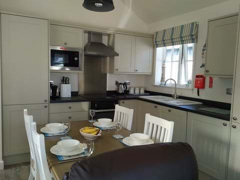 Fully equipped kitchen with oven, hob, microwave, dishwasher, full size fridge freezer and washer/dryer.