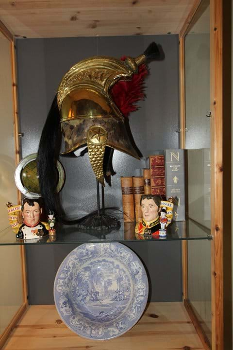 A selection of antiques adorn the shelves