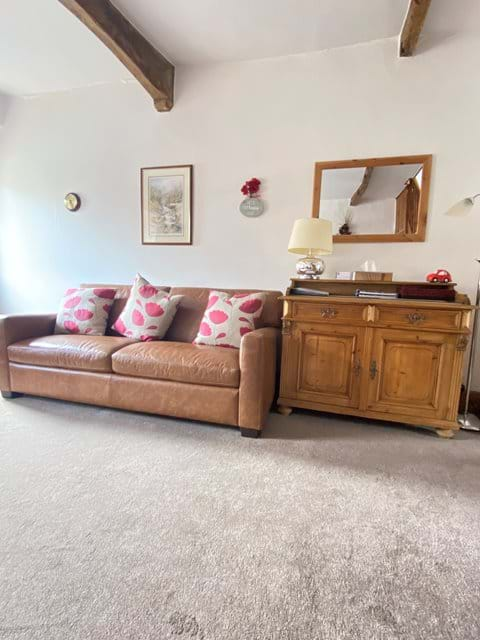 Premium leather couch new 2021. Original beams and features retained in the cottage