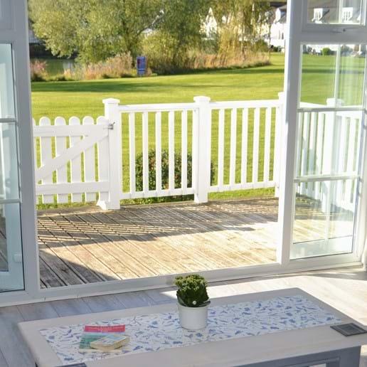 Patio doors leading to raised deck