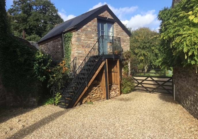 Leat Cottage, with metal steps up to first floor sitting/dining room