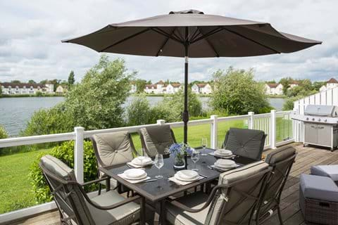 Large decking area overlooking Windrush lake