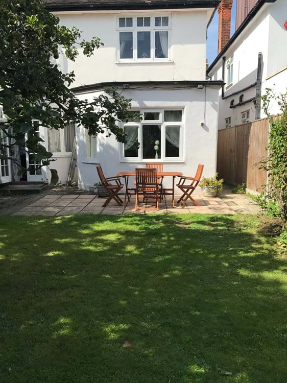 Private garden with patio and garden furniture