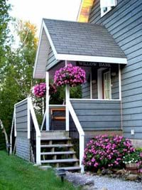 The back porch and the main entrance to the cottage