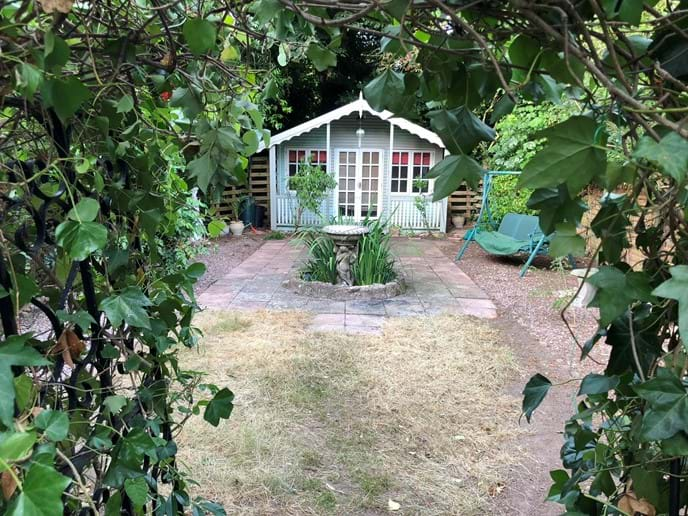 Escape to the end of the garden to read, relax or listen to the birds