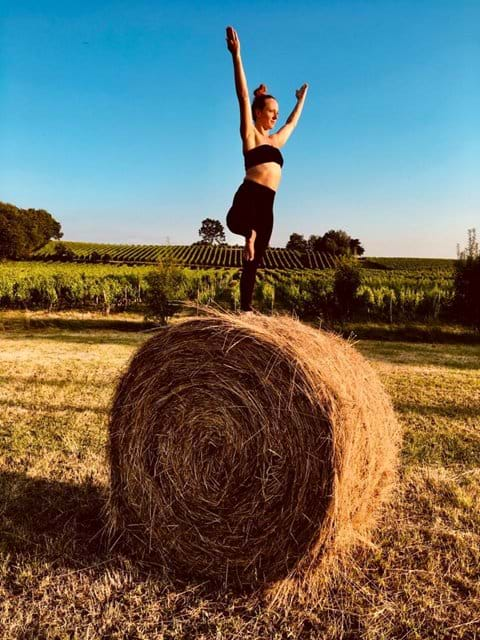 yoga woman on hay bail