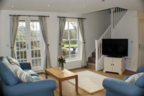Cosy living area with French windows to patio and garden